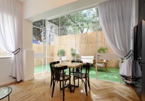 ברחוב בן יהודה דירת גן משופצת אדריכלית!